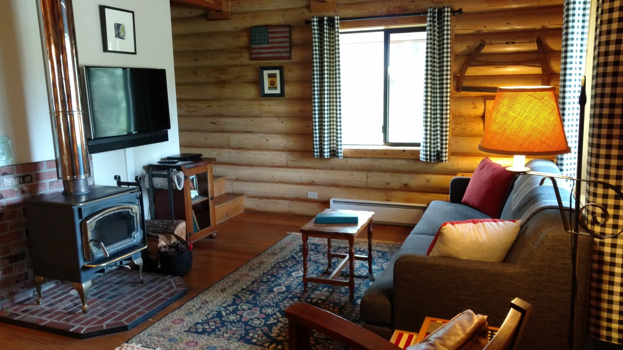 Stuchin living room with television and wood stove.
